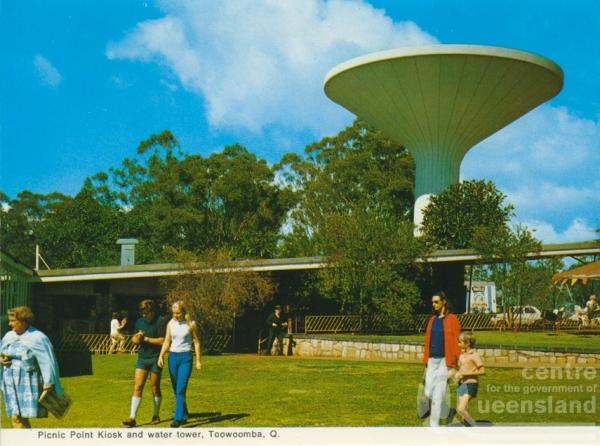 "<span class=""caption-caption"">Picnic Point Kiosk and water tower, Toowoomba</span>, c1965. <br />Postcard folder by <span class=""caption-publisher"">Murray Views Pty Ltd</span>, collection of <span class=""caption-contributor"">Centre for the Government of Queensland</span>."