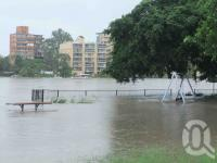 "<span class=""caption-caption"">St Lucia apartments in flood, January 2011</span>. <br />Digital image, collection of <span class=""caption-contributor"">Liz Jordan</span>."
