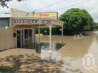 "<span class=""caption-caption"">Flood waters engulf the Convenience Store, Hoogley Street, West End, January 2011</span>. <br />Digital image, collection of <span class=""caption-contributor"">Liz Jordan</span>."