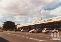 """<span class=""""caption-caption"""">Eagle Junction shops</span>, 2003. <br />Photograph, collection of <span class=""""caption-contributor"""">John Young</span>."""