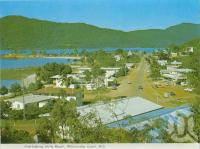 "<span class=""caption-caption"">Overlooking Airlie Beach</span>, c1970. <br />Postcard folder by <span class=""caption-publisher"">Murray Views Pty Ltd</span>, collection of <span class=""caption-contributor"">Centre for the Government of Queensland</span>."