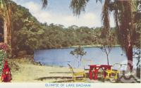 "<span class=""caption-caption"">Glimpse of Lake Eacham</span>, c1950. <br />Postcard folder by <span class=""caption-publisher"">Murray Views Pty Ltd</span>, collection of <span class=""caption-contributor"">Centre for the Government of Queensland</span>."