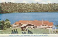 "<span class=""caption-caption"">Overlooking Lake Barrine, showing guest house</span>, c1950. <br />Postcard folder by <span class=""caption-publisher"">Murray Views Pty Ltd</span>, collection of <span class=""caption-contributor"">Centre for the Government of Queensland</span>."