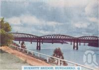 "<span class=""caption-caption"">Burnett Bridge, Bundaberg</span>, c1938. <br />Postcard folder by <span class=""caption-publisher"">Murray Views Pty Ltd</span>, collection of <span class=""caption-contributor"">Centre for the Government of Queensland</span>."