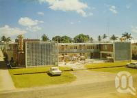 "<span class=""caption-caption"">Lyons Motel, Abbott Street, Cairns</span>, c1964. <br />Postcard by <span class=""caption-publisher"">GK Bolton</span>, collection of <span class=""caption-contributor"">Centre for the Government of Queensland</span>."