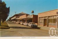 "<span class=""caption-caption"">Shamrock Street, Blackall</span>, c1964. <br />Postcard folder by <span class=""caption-publisher"">Sydney G Hughes Pty Ltd</span>, collection of <span class=""caption-contributor"">Centre for the Government of Queensland</span>."