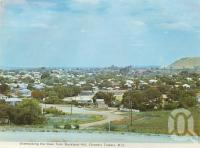 "<span class=""caption-caption"">Overlooking the town from Buckland Hill, Charters Towers</span>, c1972. <br />Postcard folder by <span class=""caption-publisher"">Murray Views Pty Ltd</span>, collection of <span class=""caption-contributor"">Centre for the Government of Queensland</span>."