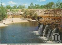 "<span class=""caption-caption"">Red Falls, Charters Towers</span>, c1972. <br />Postcard folder by <span class=""caption-publisher"">Murray Views Pty Ltd</span>, collection of <span class=""caption-contributor"">Centre for the Government of Queensland</span>."