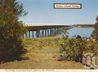 "<span class=""caption-caption"">Bribie Island bridge</span>, 1975. <br />Postcard folder by <span class=""caption-publisher"">Bernard Kuskopf</span>, collection of <span class=""caption-contributor"">Centre for the Government of Queensland</span>."