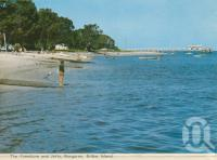 "<span class=""caption-caption"">Foreshore and jetty, Bongaree, Bribie Island</span>, 1975. <br />Postcard folder by <span class=""caption-publisher"">Bernard Kuskopf</span>, collection of <span class=""caption-contributor"">Centre for the Government of Queensland</span>."