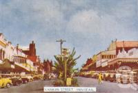 "<span class=""caption-caption"">Rankin Street, Innisfail</span>, c1952. <br />Postcard folder by <span class=""caption-publisher"">Murray Studios Pty Ltd</span>, collection of <span class=""caption-contributor"">Centre for the Government of Queensland</span>."