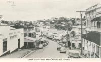 "<span class=""caption-caption"">Upper Mary Streeet and Calton Hill, Gympie</span>, c1956. <br />Postcard folder by <span class=""caption-publisher"">Murray Views Pty Ltd</span>, collection of <span class=""caption-contributor"">Centre for the Government of Queensland</span>."