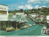 "<span class=""caption-caption"">Looking east down Mary Street, Gympie</span>, c1980. <br />Postcard folder by <span class=""caption-publisher"">Murray Views Pty Ltd</span>, collection of <span class=""caption-contributor"">Centre for the Government of Queensland</span>."