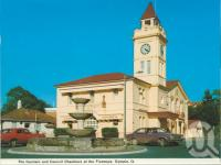 "<span class=""caption-caption"">The fountain and Council Chambers at the Fiveways, Gympie</span>, c1980. <br />Postcard folder by <span class=""caption-publisher"">Murray Views Pty Ltd</span>, collection of <span class=""caption-contributor"">Centre for the Government of Queensland</span>."