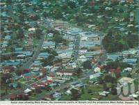 "<span class=""caption-caption"">Aerial view showing Mary Street, the commercial centre of Gympie and the prosperous Mary Valley, Gympie</span>, c1980. <br />Postcard folder by <span class=""caption-publisher"">Murray Views Pty Ltd</span>, collection of <span class=""caption-contributor"">Centre for the Government of Queensland</span>."
