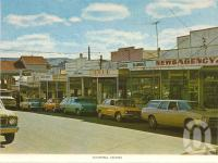 "<span class=""caption-caption"">Shopping centre, Mount Morgan</span>, c1966. <br />Postcard folder by <span class=""caption-publisher"">Sydney G Hughes Pty Ltd</span>, collection of <span class=""caption-contributor"">Centre for the Government of Queensland</span>."