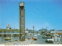 "<span class=""caption-caption"">Miles memorial clock, Marian Street, Mount Isa</span>, c1966. <br />Postcard folder by <span class=""caption-publisher"">Murray Views Pty Ltd</span>, collection of <span class=""caption-contributor"">Centre for the Government of Queensland</span>."