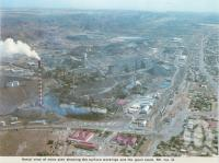 "<span class=""caption-caption"">Aerial view of the mine, Mount Isa</span>, c1966. <br />Postcard folder by <span class=""caption-publisher"">Murray Views Pty Ltd</span>, collection of <span class=""caption-contributor"">Centre for the Government of Queensland</span>."