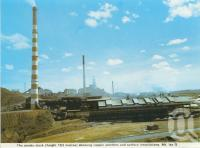 "<span class=""caption-caption"">Smoke stack, Mount Isa</span>, c1966. <br />Postcard folder by <span class=""caption-publisher"">Murray Views Pty Ltd</span>, collection of <span class=""caption-contributor"">Centre for the Government of Queensland</span>."