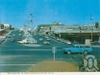 "<span class=""caption-caption"">Miles Street, Mount Isa</span>, c1972. <br />Postcard folder by <span class=""caption-publisher"">Murray Views Pty Ltd</span>, collection of <span class=""caption-contributor"">Centre for the Government of Queensland</span>."