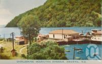 "<span class=""caption-caption"">Overlooking Mourilyan Harbour, Innisfail</span>, c1958. <br />Postcard folder by <span class=""caption-publisher"">Murray Views Pty Ltd</span>, collection of <span class=""caption-contributor"">John Young</span>."