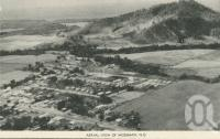 "<span class=""caption-caption"">Aerial view of Mossman</span>, c1958. <br />Postcard folder by <span class=""caption-publisher"">Murray Views Pty Ltd</span>, collection of <span class=""caption-contributor"">John Young</span>."
