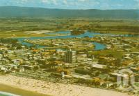 "<span class=""caption-caption"">Aerial view of Surfers Paradise looking towards Springbrook</span>, c1968. <br />Postcard by <span class=""caption-publisher"">Sydney G. Hughes Pty Ltd</span>, collection of <span class=""caption-contributor"">Centre for the Government of Queensland</span>."