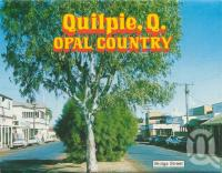 """<span class=""""caption-caption"""">Brolga Street Quilpie</span>, c1962. <br />Postcard folder by <span class=""""caption-publisher"""">Murray Views Pty Ltd</span>, collection of <span class=""""caption-contributor"""">Centre for the Government of Queensland</span>."""