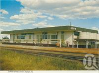 """<span class=""""caption-caption"""">Quilpie Railway Station</span>, c1962. <br />Postcard folder by <span class=""""caption-publisher"""">Murray Views Pty Ltd</span>, collection of <span class=""""caption-contributor"""">Centre for the Government of Queensland</span>."""