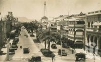 "<span class=""caption-caption"">Flinders Street, Townsville</span>, c1936. <br />Postcard by <span class=""caption-publisher"">JW Laurie</span>, collection of <span class=""caption-contributor"">Centre for the Government of Queensland</span>."