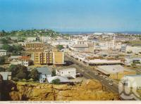 "<span class=""caption-caption"">General view of city from cutting, Townsville</span>, 1973. <br />Postcard folder by <span class=""caption-publisher"">Murray Views Pty Ltd</span>, collection of <span class=""caption-contributor"">Centre for the Government of Queensland</span>."