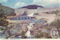 "<span class=""caption-caption"">The spillway, Koombooloomba Dam, south of Ravenshoe</span>, c1960. <br />Postcard folder by <span class=""caption-publisher"">Murray Views Pty Ltd</span>, collection of <span class=""caption-contributor"">Centre for the Government of Queensland</span>."