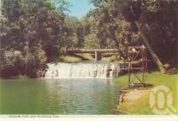 "<span class=""caption-caption"">Malanda Falls and swimming pool</span>, c1960. <br />Postcard folder by <span class=""caption-publisher"">Murray Views Pty Ltd</span>, collection of <span class=""caption-contributor"">Centre for the Government of Queensland</span>."