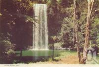 "<span class=""caption-caption"">Millaa Millaa falls</span>, c1960. <br />Postcard folder by <span class=""caption-publisher"">Murray Views Pty Ltd</span>, collection of <span class=""caption-contributor"">Centre for the Government of Queensland</span>."