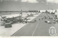 "<span class=""caption-caption"">Eagle Farm Airport</span>, 1964. <br />Postcard folder by <span class=""caption-publisher"">John Sands Pty Ltd</span>, collection of <span class=""caption-contributor"">Centre for the Government of Queensland</span>."