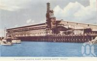 "<span class=""caption-caption"">Bulk sugar loading wharf showing gantry, Mackay</span>, c1956. <br />Postcard folder by <span class=""caption-publisher"">Murray Views Pty Ltd</span>, collection of <span class=""caption-contributor"">Centre for the Government of Queensland</span>."