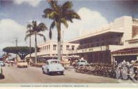 "<span class=""caption-caption"">Corner of Sydney and Victoria Streets, Mackay</span>, c1956. <br />Postcard folder by <span class=""caption-publisher"">Murray Views Pty Ltd</span>, collection of <span class=""caption-contributor"">Centre for the Government of Queensland</span>."