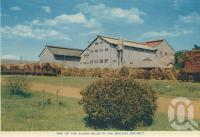 "<span class=""caption-caption"">One of the sugar mills in the Mackay district</span>, c1960. <br />Postcard folder by <span class=""caption-publisher"">Sydney G Hughes Pty Ltd</span>, collection of <span class=""caption-contributor"">Centre for the Government of Queensland</span>."
