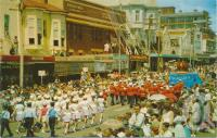 "<span class=""caption-caption"">The parade, Carnival of Flowers, Ruthven Street, Toowoomba</span>, c1964. <br />Postcard by <span class=""caption-publisher"">Murray Views Pty Ltd</span>, collection of <span class=""caption-contributor"">Centre for the Government of Queensland</span>."