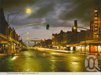 "<span class=""caption-caption"">Ruthven Street at night, Toowoomba</span>, c1965. <br />Postcard folder by <span class=""caption-publisher"">Murray Views Pty Ltd</span>, collection of <span class=""caption-contributor"">Centre for the Government of Queensland</span>."