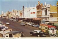 "<span class=""caption-caption"">Ruthven Street, Toowoomba</span>, c1960. <br />Postcard folder by <span class=""caption-publisher"">Murray Views Pty Ltd</span>, collection of <span class=""caption-contributor"">Centre for the Government of Queensland</span>."