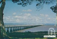 "<span class=""caption-caption"">Cleveland jetty</span>, c1980. <br />Postcard folder by <span class=""caption-publisher"">Sydney G Hughes Pty Ltd</span>, collection of <span class=""caption-contributor"">Centre for the Government of Queensland</span>."