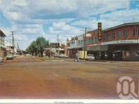 "<span class=""caption-caption"">Wills Street, Charleville</span>, c1980. <br />Postcard folder by <span class=""caption-publisher"">Murray Views Pty Ltd</span>, collection of <span class=""caption-contributor"">Centre for the Government of Queensland</span>."