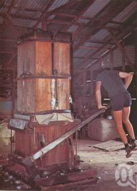 "<span class=""caption-caption"">Pressing wool manually, Charleville</span>, c1980. <br />Postcard folder by <span class=""caption-publisher"">Murray Views Pty Ltd</span>, collection of <span class=""caption-contributor"">Centre for the Government of Queensland</span>."