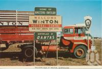 "<span class=""caption-caption"">Welcome sign at Winton</span>, c1960. <br />Postcard folder by <span class=""caption-publisher"">Murray Views Pty Ltd</span>, collection of <span class=""caption-contributor"">Centre for the Government of Queensland MS</span>."