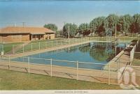 "<span class=""caption-caption"">Swimming baths, Winton</span>, c1960. <br />Postcard folder by <span class=""caption-publisher"">Murray Views Pty Ltd</span>, collection of <span class=""caption-contributor"">Centre for the Government of Queensland MS</span>."
