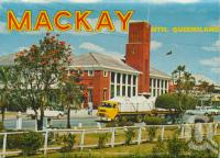 "<span class=""caption-caption"">Mackay Post Office with bulk sugar transport truck passing by</span>, c1966. <br />Postcard folder by <span class=""caption-publisher"">Sydney G Hughes Pty Ltd</span>, collection of <span class=""caption-contributor"">Centre for the Government of Queensland MS</span>."