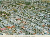 "<span class=""caption-caption"">Aerial view of the main business area of Mackay</span>, c1966. <br />Postcard folder by <span class=""caption-publisher"">Sydney G Hughes Pty Ltd</span>, collection of <span class=""caption-contributor"">Centre for the Government of Queensland MS</span>."