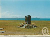 "<span class=""caption-caption"">Memorial to the 'Fokker Friendship' crash victims in 1960 at Far Beach showing Flat and Roundtop Islands</span>, c1966. <br />Postcard folder by <span class=""caption-publisher"">Sydney G Hughes Pty Ltd</span>, collection of <span class=""caption-contributor"">Centre for the Government of Queensland MS</span>."