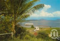 "<span class=""caption-caption"">Overlooking the harbour, Port Douglas</span>, c1976. <br />Postcard by <span class=""caption-publisher"">Murray Views Pty Ltd</span>, collection of <span class=""caption-contributor"">Centre for the Government of Queensland</span>."